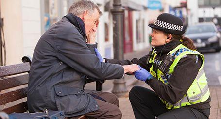 police officer speaks to member of the public