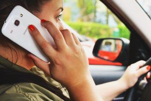 Person driving with mobile phone