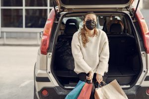 Woman who has been shopping wearing a mask